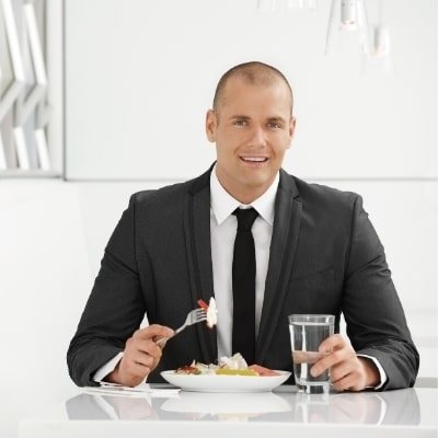 Business man eating healthy